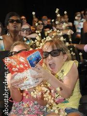 Children Eating Popcorn At Cinema