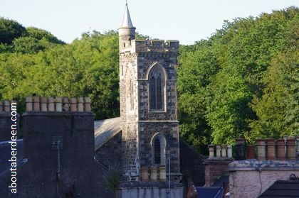 Church tower with trees in background