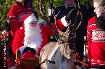 Santa being pulled by reindeer on sleigh