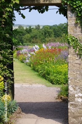 glimpse of a walled garden through archway