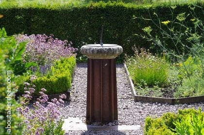 sundial in herbaceous borders